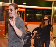 Angelina Jolie and Brad Pitt are seen at Tokyo International Airport on July 28, 2013 with two of their six children -- Pax, 9, and Vivienne, 5.