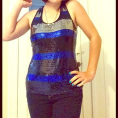 striped sequined tank top blue, black, and silver striped, sequined racerback tank top from forever 21. love the little ribbon bow detailing on the back! super comfy and cute for a night out! Selling because it's not something i wear often! size medium and has a bit of stretch to material! Forever 21 Tops Tank Tops