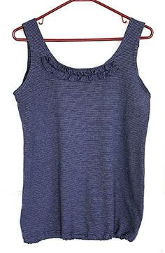 A tank top tutorial that shows how to make your own tank top from a recycled t-shirt.