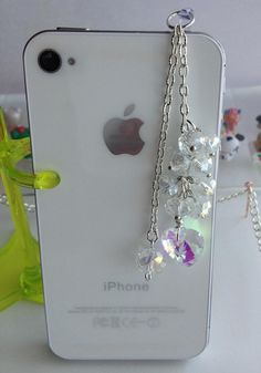 iphone dust plug Phone dust plug and phone charm by ComfyZone, $9.00