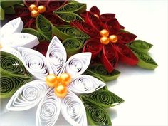 Paper Poinsettia Ornaments    What you need: For each flower you'll need 11 strips of paper 3/4 in wide and approximately 17 inches long; 3 gold beads; white glue; a quilling tool (or toothpick); and string (for hanging the ornaments)