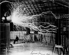 Nikola Tesla in his lab at Colorado Springs, circa 1900. A double exposure was used to capture the electrical discharge of this advanced Tesla Coil. I know it's almost lame now to adore Tesla because everyone's doing it but I adore Tesla.