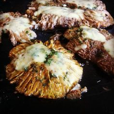 Baked mushrooms with cheddar on top.