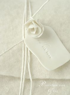 Lovely tag idea...will try w/ polymer clay. ~ link does not take you to the original....