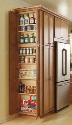 what about adding this w/door to one or both end kitchen cabinets This Utility Cabinet's adjustable shelves make storing all of your pantry items easy and give you the space you need. By Thomasville Cabinetry. Diy Kitchen Storage, Kitchen Redo, Kitchen Organization, Kitchen And Bath, New Kitchen, Kitchen Cabinets, Kitchen Ideas, Hidden Kitchen, Organization Ideas