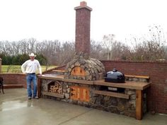 What about something like this (minus the over the top chimney?) rustic outdoor kitchen ideas | Rustic Outdoor Kitchen Designs: Rustic Outdoor Kitchen Designs ...