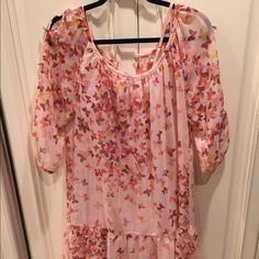 Pink flower flowy dress Perfect condition. Looooove this dress...sad to see it go:( hangs too much on the top for me, but otherwise it's a great fit and looks adorable with a belt LC Lauren Conrad Dresses