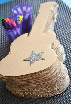 "Cut out cardboard guitar shapes and let each student decorate them on the first day of school for a ""rockin'"" bulletin board!"
