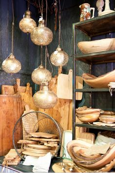 Hanging light display with cutting boards and wooden objects