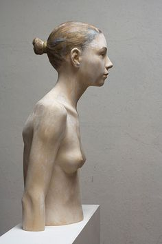 Modern work by Bruno Walpoth who is an artist which makes incredible human sculptures from wood.