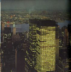 Night view of Park Avenue's new 50-story glass supertowers from R.C.A. Building in the spring of 1966. View looking east showing the 52-story Union Carbide Building (Skidmore, Owings & Merrill, 1960) on foreground, at center with the 50-story Chemical Bank New York Trust Building (Emery Roth & Sons, 1964) behind it, and the new 51-story 245 Park Avenue Building (Shreve, Lamb & Harmon, 1967) under construction at right. Photo: Serraillier/Rapho