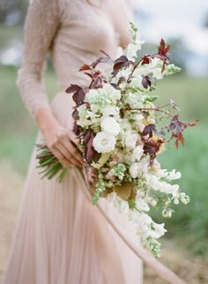 Intertwined with leaves: http://www.stylemepretty.com/2015/09/14/25-breathtaking-bouquets-perfect-for-fall/