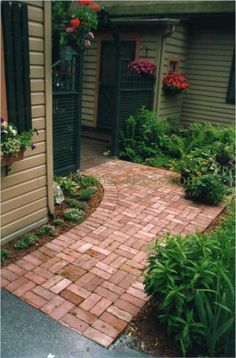 walkway idea for front of house. i like the idea of adding color with brick pavers. and green edging.