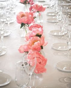 It doesn't take much to make a beautiful statement: this couple filled short glass vases with flamingo-pink peonies. | Chic Fashion Pins : The Cutest Pins Around!!!