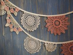 This lovely handmade vintage bunting is from our Vintage Doily range and is the perfect ingredient for any party, wedding or room.  Measurements – This bunting comes in a 3 metre batch, this batch has 12 semi circular and circular style doilies on. The binding is off white and is 3m long and there are approximately 30cm of tie at each end.  Fabrics - This bunting has been made out of a selection of beautiful hand crochet doilys making it totally unique. These are great to decorate a wedding…
