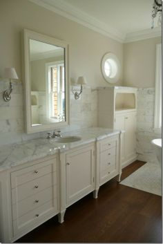 there are quite a few master bathroom spaces that don't seem to have a designated place for the hand towel.  Designer and blogger Brooke Giannetti designed this space – I must ask her whether the intent is for the hand towel to rest on the counter or be hidden away.