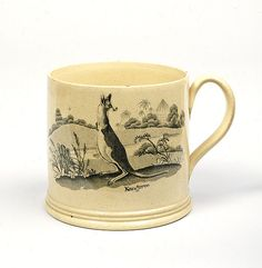 Staffordshire mug c.1800.  Earthenware, slip cast creamware, transfer printed and painted decoration slip cast with transfer and painted decoration.  10.3 h x 15.0 w x 11.7 d cm.  Purchased by the Australian National Gallery in 1980.