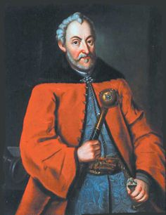 Polish magnate Jan Zamoyski (1542–1605) dressed in a crimson delia over a blue silk żupan, and tied with a pas kontuszowy. The right hand holds a buława.