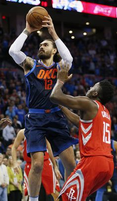 Oklahoma City's Steven Adams shoots as Houston's Clint Capela defends during Monday's game between the Oklahoma City Thunder and the Houston Rockets at Chesapeake Energy Arena. [Photo by Nate Billings, The Oklahoman]