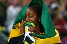 Shelly-Ann Fraser-Pryce of Jamaica celebrates winning the gold in the women's 100-meter final on Aug. 4 at the Olympic Stadium. (Alexander Hassenstein/Getty Images)