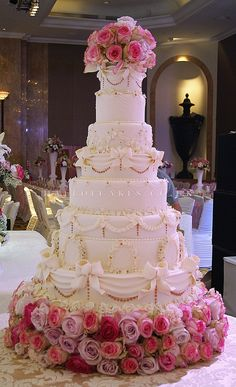 Classic tall wedding cake ... All  you need to plan your perfect  wedding ... https://itunes.apple.com/us/app/the-gold-wedding-planner/id498112599?ls=1=8  ♥  The Gold Wedding Planner iPhone #App ♥ http://pinterest.com/groomsandbrides/boards/ #Pastel #Pale #Pink #Fuchsia #Magenta #White #Wedding