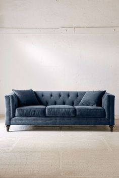 Graham Velvet Sofa in Dark Blue -Urban Outfitters