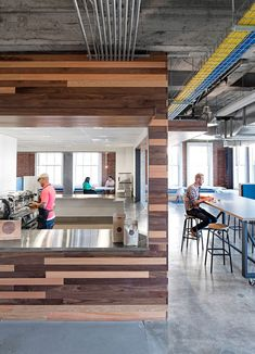 Exposed brick and concrete features inside Yelp's San Francisco headquarters.