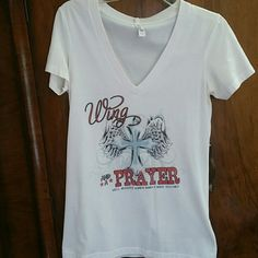 White tee with cross Soft v neck tee.  Worn once.  Tag reads large but fits smaller. Tops Tees - Short Sleeve