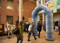 Monument to Waste: Arch-shaped sculpture made from trashed water bottles - Eco Friend