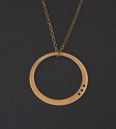 Luna Brass Necklace | A shining metal orb hangs from an antiqued brass chain in this... | Necklaces