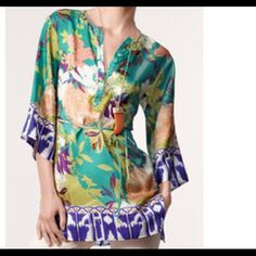"""CAbi Poetry Tunic 812 CAbi """"Poetry"""" 100% Silk Tunic Style 812 EUC  Button placket in front and vents at the hem at each side Beautiful floral print 3/4 Sleeves Two small loops in back seams as shown. Tie belt included CAbi Tops Tunics"""