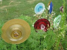 Gold, red, light blue, dark blue, purple and green glass garden ornaments