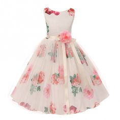 A floral pattern will add flavor and a distinctive allure to this sleeveless gown from Kiki Kids USA.
