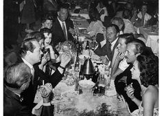 Humphrey Bogart and Lauren Bacall were part of Hollywood's social scene, called The Hombly Hills Rat Pack. Cocktails at the Copa Room (1956) Left to Right:  Bogart, producer Sid Luft, Bacall, Ellie Graham, agent Jack Entratter, restaurateur Mike Romanoff (partly hidden), Frank Sinatra, Mrs Romanoff, David Niven & Mrs Niven