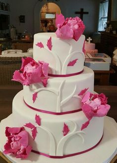 White wedding cake with pink sugar flowers