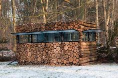 Log House on Wheels - Designed by Piet Hein Eek, best known for designing lovely scrap wood furniture, this tree-trunk house was commissioned by a musician and serves as his office. It sits on the edge of the woods in Hilversum, Netherlands.