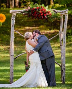 Woodland wedding ceremony backdrop: Tree Branch Huppah With Statement Floral Arrangement