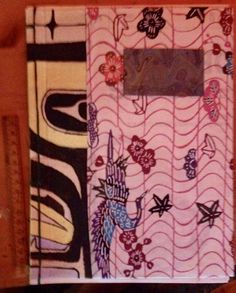 notebook - bound with painted chilkat design, japanese paper and lined writing paper.