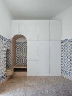 Aurora Arquitectos knocked through walls to create a large living room in this old Lisbon apartment, and inserted a wall with curving edges to form a pair of bedrooms.