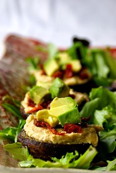 Fully Loaded Mushrooms: lightly roasted and stuffed with homemade hummus, sun-dried tomatoes, and diced avocado!