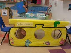 A painted submarine. I used transparent sheets for the windows. I also added books about the ocean and sea animals for children to read while in the submarine.