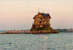 Four-story house on tiny island in Narragansett Bay, RI...wonderful small(est) state with picturesque coast line and charming small towns, including Newport, once the playground of the extremely wealthy and home to fabulous historic mansions.