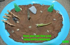 Dino Land with mocha glitter playdough.  My 3yr loved this
