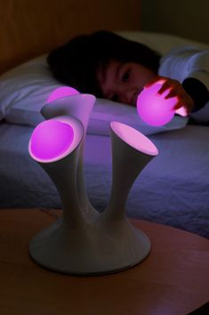 Glowing nightlight lamp with removable glo balls for trips to the bathroom.