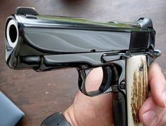 paradynamic:  therevenantrising:  cfreezy:  k-catch:  So slick and  shiny    That's a Clarks custom meltdown. Very elegant  It's actually too smooth for me.  I don't like it.   Yeah, I don't like ultra-dehorning on 1911s, makes them look like they're carved from soap