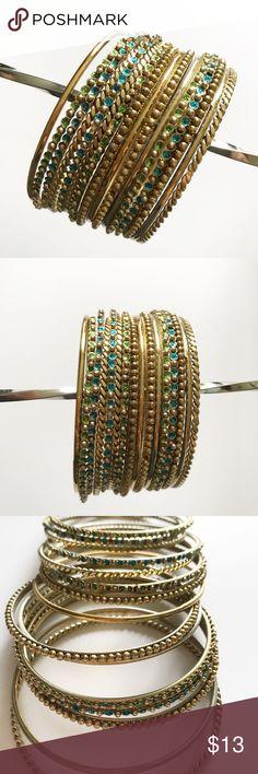 Beautiful Indian style bangle bracelets set Beautiful set of Indian style bracelet. Blue, green and gold. Never worn. Bundle discount offered. Jewelry Bracelets