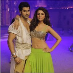 Glam People - Parineeti Chopra and Varun Dhawan Glam Check - For those who haven't watched Dishoom, here is a news. The cute Pari is a part of the movie too, she is paired opposite varun in the song JAANEMAN AAH  Parineeti shared a picture from her song with Varun Dhawan in the movie Dishoom!  Neon crush on Parineeti!! Silver glitter top with lace detail is super glamorous. The neon green skirt looks hot with the silver top. The hand accessory makes the look interesting.