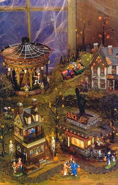 """Halloween Village Display / Dept. 56 Halloween Display / Department 56 """"Ghostly Carousel"""", """"Spooky Farmhouse"""", """"Helga's House of Fortunes"""" and """"Black Cat Diner"""" / from - Google search image"""