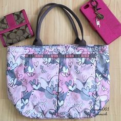 """LeSportsac Pink Graffiti Hearts Tote Handbag This casual but yet so chic graffiti hearts themed Le Sports Sac Tote comes to you in excellent condition. Only used a handful so there are no stain or rips. Measures: 14"""" x 9"""" x 5.5"""". Handle drop is 6.5"""" & will sit comfortably on your shoulder or over your arm. 1 zippered pocket on the outside front of the tote that runs the length of the bag. 1 zippered pocket on the inside. Very roomy & a great addition to any girl's handbag collection. Coach…"""