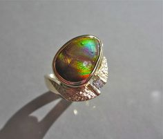 One of a kind fire agate and diamond ring by Glenn Dizon Designs. Finished yesterday and now available. Fire agate 5.11 carats, diamond .11 F VS. Message me for pricing. Design is curved to fit the contours of the hand and looks so AWESOME on!